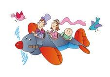 Familia en el avión Imagen de archivo