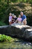 Familia en el jardín Imagen de archivo libre de regalías