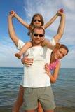 Familia en el mar Fotografía de archivo