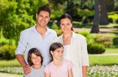 Familia en el parque Foto de archivo libre de regalías