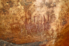 Familia en el pictograma de la roca del bosquimano prehistórico Fotografía de archivo libre de regalías