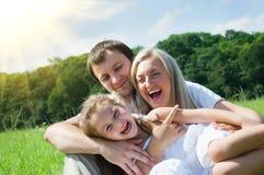 Familia en el prado Imagen de archivo libre de regalías