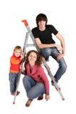 Familia en el step-ladder imágenes de archivo libres de regalías