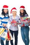 Familia en hacer compras para la Navidad Fotos de archivo