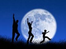 Familia en la luna Imagen de archivo libre de regalías