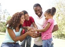 Familia en parque con fútbol americano fotografía de archivo libre de regalías