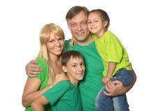 Familia en ropa verde Foto de archivo libre de regalías