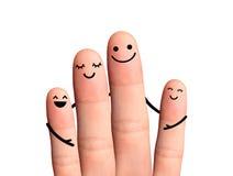 Familia feliz, aislada con las trayectorias de recortes en el fondo blanco. Imagen de archivo libre de regalías