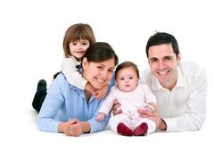 Familia feliz aislada en blanco Imagen de archivo