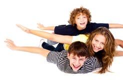 Familia feliz aislada en el fondo blanco Fotografía de archivo libre de regalías