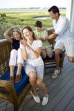 Familia feliz con dos adolescentes en terraza Imagen de archivo