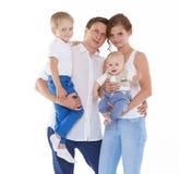Familia feliz con dos bebés Foto de archivo libre de regalías