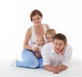 Familia feliz con dos bebés Imágenes de archivo libres de regalías