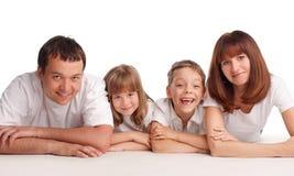 Familia feliz con dos niños Imagen de archivo libre de regalías