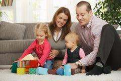 Familia feliz con el bebé y el niño Imagen de archivo