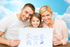 Familia feliz con el dibujo o la imagen Imagen de archivo libre de regalías