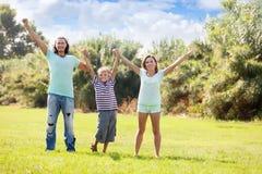 Familia feliz con el hijo adolescente Imagenes de archivo