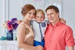 Familia feliz con el niño Foto de archivo libre de regalías