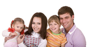 Familia feliz con el niño dos. Fotos de archivo libres de regalías