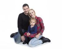Familia feliz con la pequeña hija Foto de archivo
