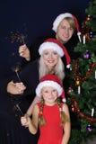 Familia feliz con las luces fotos de archivo libres de regalías