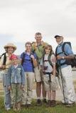 Familia feliz con las mochilas Imagen de archivo