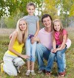 Familia feliz con los niños Foto de archivo libre de regalías
