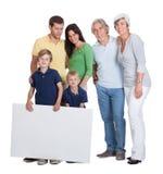 Familia feliz de las generaciones foto de archivo libre de regalías