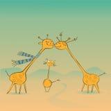 Familia feliz de las jirafas Imágenes de archivo libres de regalías