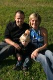 Familia feliz de tres Foto de archivo libre de regalías