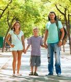 Familia feliz de tres con el adolescente Imágenes de archivo libres de regalías