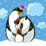 Familia feliz de tres pingüinos ilustración del vector