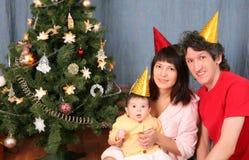 Familia feliz el día de fiesta del Año Nuevo Fotos de archivo libres de regalías
