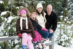 Familia feliz en el invierno Imagen de archivo libre de regalías