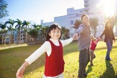 Familia feliz en la escuela Imagen de archivo libre de regalías