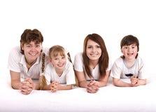 Familia feliz: madre, padre, hija, hijo. Foto de archivo libre de regalías