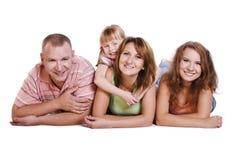 Familia feliz. Madre, padre y dos hijas Fotos de archivo libres de regalías