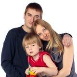 Familia feliz. Padre, madre y niño Fotos de archivo libres de regalías