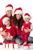 Familia feliz que celebra la Navidad Imagen de archivo