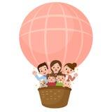 Familia feliz que monta un globo Fotos de archivo libres de regalías