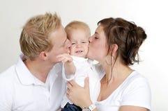Familia feliz. querer a su niño Imagen de archivo libre de regalías