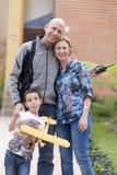 Familia feliz y afición Fotos de archivo
