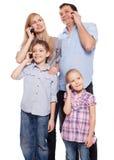 Familia, hablando en el teléfono Fotos de archivo libres de regalías