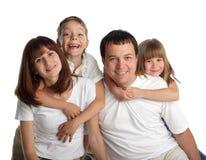 Familia hermosa con dos niños Imagenes de archivo