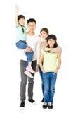 Familia joven atractiva feliz que se une Imagen de archivo libre de regalías