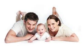 Familia joven con el bebé Imagenes de archivo