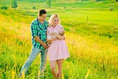 Familia joven con el bebé Imagen de archivo libre de regalías