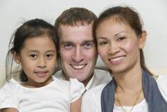 Familia joven con la niña Fotografía de archivo