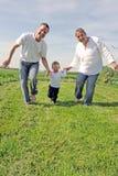 Familia joven con un niño Fotografía de archivo