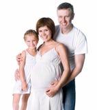 Familia joven con un niño Imagenes de archivo